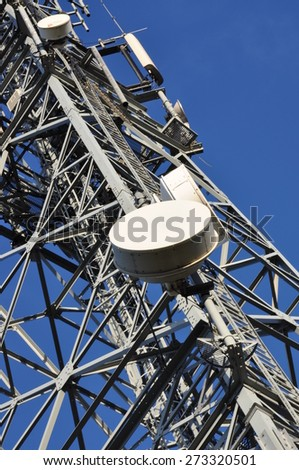 Telecommunication tower with antennas against the blue sky  - stock photo