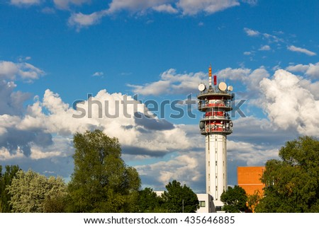 Telecommunication tower with antennas and blue sky - stock photo