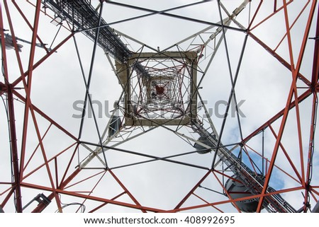 Telecommunication tower with antennas from below - stock photo