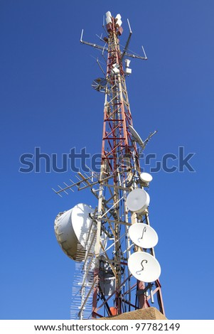 Telecommunication tower with antennas on blue sky/Telecommunication tower