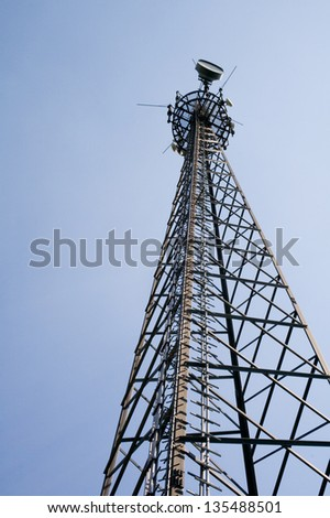Telecommunication tower with blue sky background - stock photo