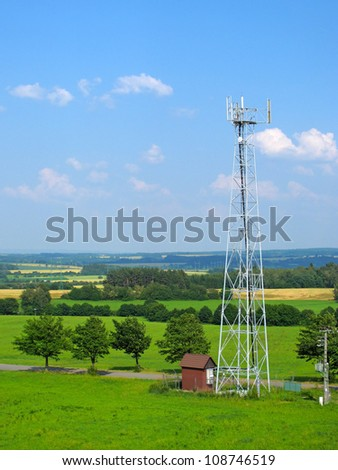 Telecommunication tower with different antenna in natural landscape. - stock photo