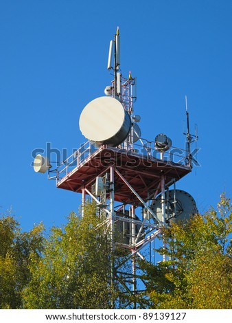 Telecommunication tower with different antennas. - stock photo
