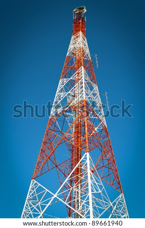 Telecommunication Tower witht a blue sky background. - stock photo