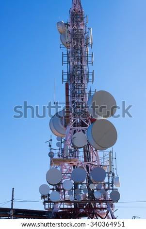 Telecommunications antenna for radio, TV  and telephony whit  Blue sky - stock photo