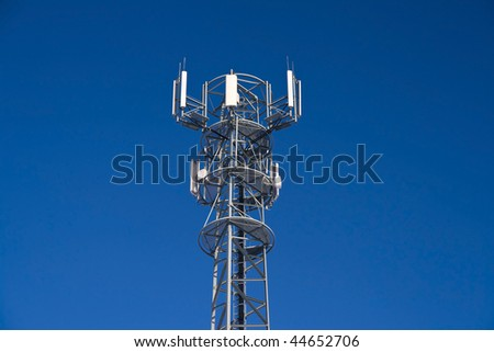 Telecommunications mast with blue sky background