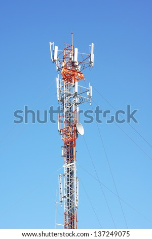 telecommunications tower against blue sky   Save to a lightbox?   find similar images   share? Telecommunications tower against blue sky