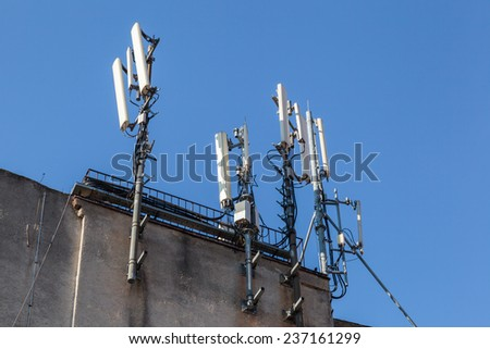 Telecommunications tower. Mobile phone base station - stock photo
