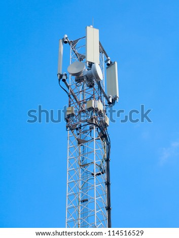 telecommunications tower on a blue sky - stock photo