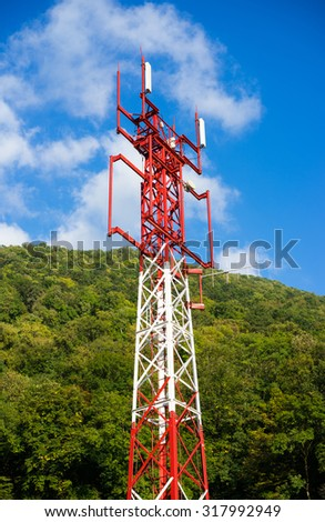 Telecommunications tower over blue sky background - stock photo