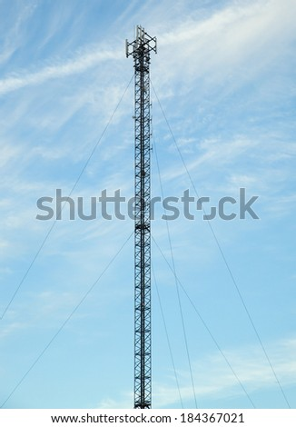 Telecommunications tower with antennas for GSM coverage and 3G/4G directional antennas - stock photo