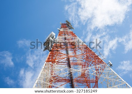 Telecommunications tower with clear blue sky - stock photo
