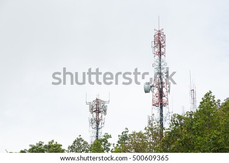 Telecommunications towers, located in a forest area on the mountain.