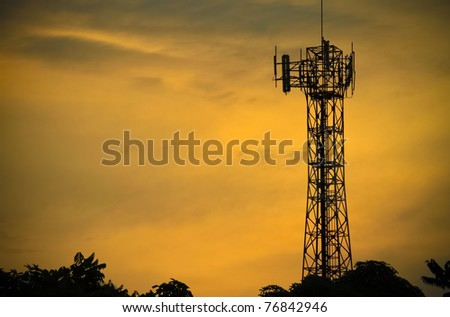 Telecommunications towers near the secret sky after the Sun. - stock photo