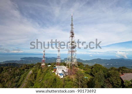 Telecommunications towers on the top of the hill, Langkawi, Malaysia. - stock photo
