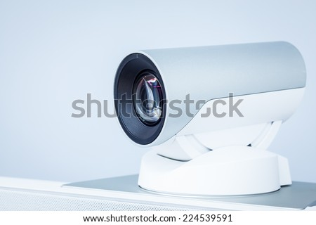 teleconference, video conference or telepresence camera closeup - stock photo