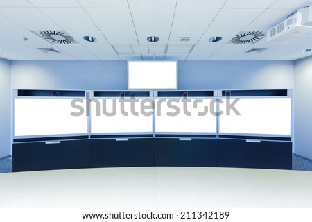 teleconferencing, video conference and telepresence business meeting room with blank screen display monitor - stock photo