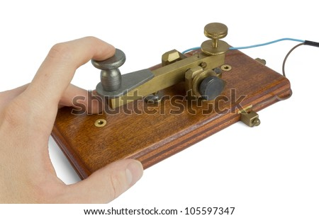 Telegraph key being used by an operator