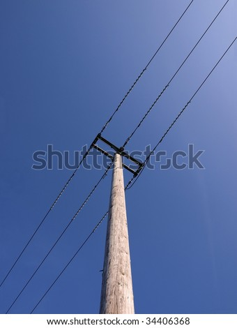 Telegraph Pole set against Blue Sky
