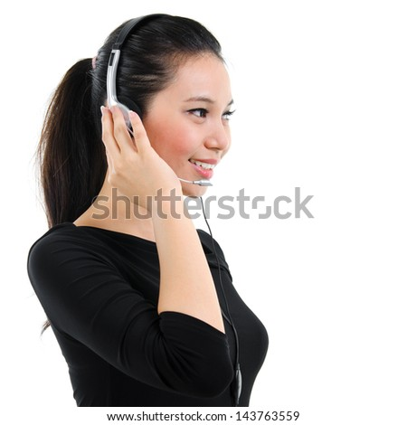 Telemarketing headset woman from call center smiling happy talking in hands free headset device. Attractive mixed race Southeast Asian / Caucasian business woman isolated on white background. - stock photo