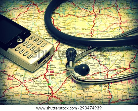 Telemedicine, telehealth set: Stethoscope and mobile phone on the public road map