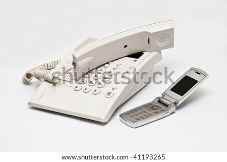 Telephone and cellphone isolated on white