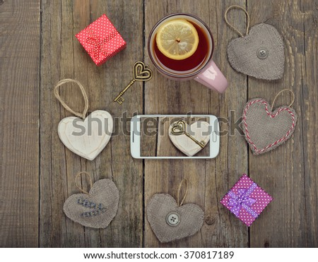 Telephone and different accessories on a wooden background, Valentine's Day concept