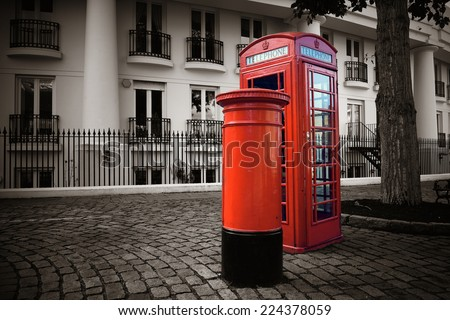 Telephone box and mail box in London street. - stock photo