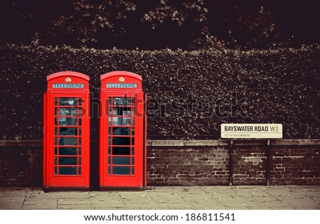 Telephone box in London street. - stock photo
