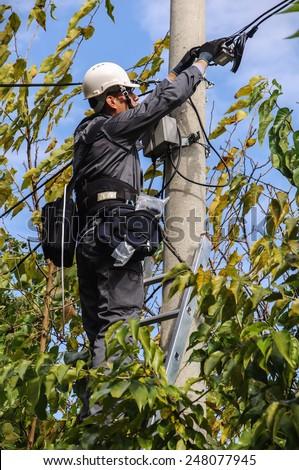 Telephone Engineer At Work - stock photo