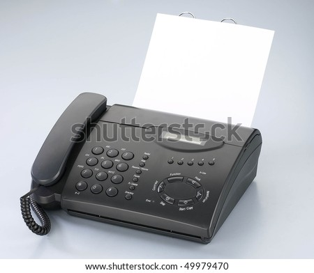 Telephone/ fax machine with handle on the hook. - stock photo