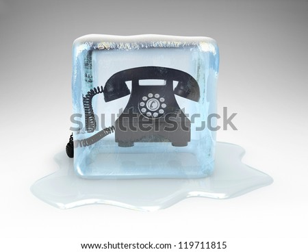 Telephone frozen in a block of ice - stock photo