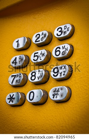 Telephone keyboard in public phone - stock photo