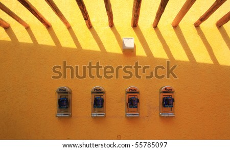 telephone on the wall,cozumel,Mexico. - stock photo