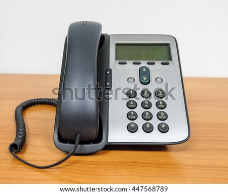 telephone on working table in room service network and internet office with note book - stock photo