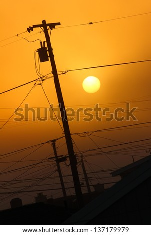 Telephone Pole and Lines in Sunset - stock photo