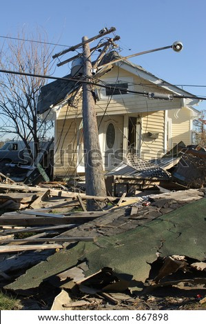 Telephone pole destroys house - 9th Ward New Orleans - stock photo