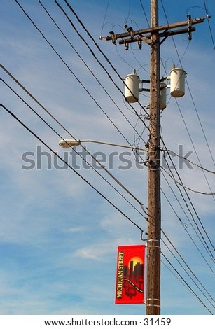telephone pole with banner - stock photo