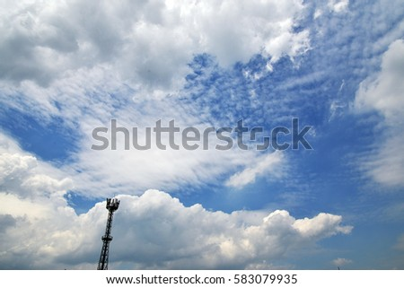 Telephone Pole with Clear Blue Sky and Clouds