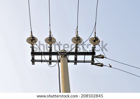 Telephone poles and wires and the blue sky  - stock photo