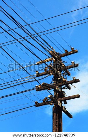 Telephone poles with wires for communication. - stock photo