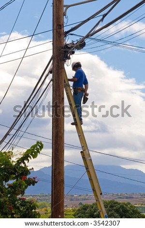 Telephone Repair man installing to cable services to costumers - stock photo
