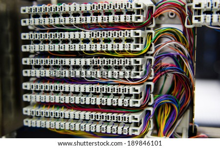 Telephone switchboard panel and wiring for analog telephone.  - stock photo