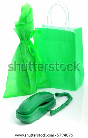 telephone with a shopping bag and a gift wrapped wine on the background