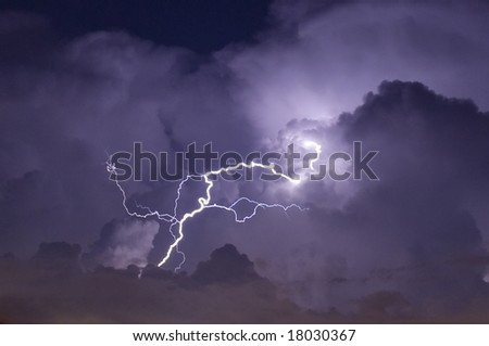 Telephoto image of a Lightning strike during a night storm - stock photo