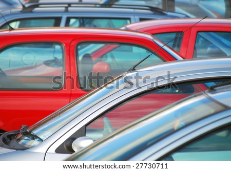 Telephoto image of cars parked in car park - stock photo