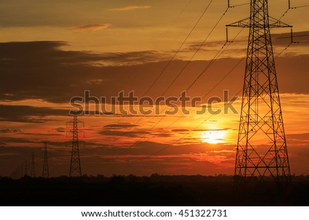 Telephoto of electric pole at sunset background