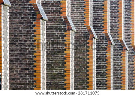 Telephoto shot of exterior of a church in Maastricht, the Netherlands, resulting in an abstract image of repetition - stock photo