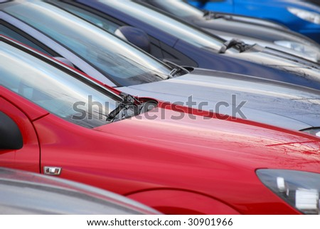 Telephoto view of cars parked in car park - stock photo