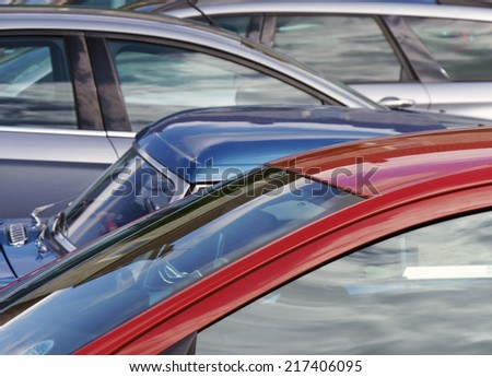 Telephoto view of cars parked in city center - stock photo